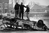 Loyalist youths standing on a burnt out car, Tyndale estate, Belfast, Northern Ireland 1986 Loyalists one day strike against Anglo-Irish agreement - John Sturrock - ,1980s,1986,against,agreement,AGREEMENTS,Anglo-Irish agreement,AUTO,AUTOMOBILE,AUTOMOBILES,AUTOMOTIVE,balaclava,balaclavas,burnt,Burnt Out,car,cars,cities,city,CLJ,conflict,conflicts,damage,damaged,da