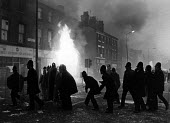 Liverpool police re-occupy Upper Parliament St, in the Toxteth Riot. - John Sturrock - ,1980s,1981,adult,adults,BME Black minority ethnic,burn,burning,BURNS,cities,city,civil,CLJ,disorder,disturbance,fire,fires,force,inner-city,line,lines,Liverpool,Liverpool 8,male,man,MATURE,men,Night,