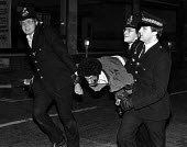 SPG arrest of black youths, in Acre Lane near the Town Hall, at the Brixton riot. - John Sturrock - 11-04-1981