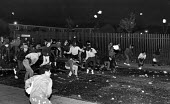Toxteth Riot on Kingsley Rd, rioters advancing onto Upper Parliament St, in Liverpool. - John Sturrock - ,1980s,1981,adult,adults,anger,angry,BAME,BAMEs,black,BME,BME Black minority ethnic,bmes,boy,boys,child,CHILDHOOD,children,cities,city,civil,CLJ,cultural,disorder,disturbance,diversity,EMOTION,EMOTION
