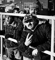 Miners Strike at Wheldale Colliery, Castleford Pickets jeer, as six strike breaking miners leave the pit at the end of their shift. - John Sturrock - 1980s,1985,anger angry,breaker,breakers,breaking,coal,Coal mining,colleague colleagues,collieries,Colliery,colliery collieries,communicating,communication,cross,crosses,crossing,DISPUTE,DISPUTES,INDUS