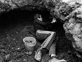The Miners Strike, Upton near Pontefract. Digging for fragments of coal in the waste tip of a colliery. A youth was killed a few days previously on this tip, when an overhang he was working under coll... - John Sturrock - 11-09-1984