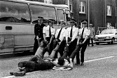 Miners Strike, polices stop coaches of miners traveling to picket coal leaving British Steels Hunterston Terminal. The 300 miners then sat down in the road and were dragged away by police and arrested... - John Sturrock - 1980s,1984,adult,adults,arrest,arrest arresting,arrested,arresting,bus buses,CLJ,coach coaches,coal,DISPUTE,DISPUTES,drag dragged,force,INDUSTRIAL DISPUTE,leaving,man men,MATURE,member,member members,