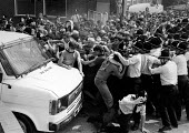 Pickets try to reach a van carrying three scabs as they leave Allerton Bywater pit. Yorkshire. Miners strike 1984 - John Sturrock - 21-08-1984