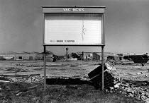 Job Vacancies sign, demolished Slough trading estate during the recession, 1983 - John Sturrock - 1980s,1983,board,boards,brick,bricks,Buckinghamshire,building,buildings,capitalism,capitalist,close,closed,closing,closure,closures,communicating,communication,decay,deindustrialisation,Deindustrializ