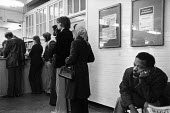 Waiting, employment Exchange, Battersea, London - John Sturrock - ,1980s,1982,BAME,BAMEs,benefit,benefits,black,BME,BME Black minority ethnic,bmes,bored,boredom,boring,cities,city,counter,counters,cultural,deindustrialisation,Deindustrialization,depressed,depression