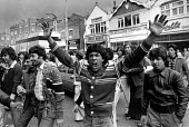 Southall Riot. Before the National Front meeting, youths attempted to block the centre of Southall. Police intervened and there were many arrests. - John Sturrock - ,1970s,1979,activist,activists,adult,adults,against,anger,Angry,asian,asians,BAME,BAMEs,bigotry,Black,BME,BME minority ethnic Protest,bmes,CAMPAIGNING,CAMPAIGNS,cities,City,DEMONSTRATING,Demonstration
