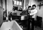 Tenants in an unmodernised flats in Brune House, owned by Tower Hamlets Council. The flats are mainly occupied by Asian familes, who not only have to put up with damp conditions, but have bathrooms an... - John Sturrock - ,1980s,1986,asian,asians,BAME,BAMEs,bath,bathroom,bathrooms,baths,Black,BME,BME Black minority ethnic,BME minority ethnic,bmes,boy,boys,carries,carry,carrying,child,CHILDHOOD,children,cities,city,coun