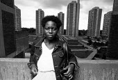 A resident of the Nightingale Estate, in Hackney. - John Sturrock - 1980s,1986,ace,apartment,architecture,BAME,BAMEs,Black,blocks,BME,BME Black minority ethnic,bmes,building,buildings,cities,city,cityscape,cityscapes,council estate,Council Housing,council services,cou