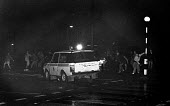 Police Range Rover driving at pickets. Mass picket, Cortonwood pit village, Brampton, Yorkshire - John Sturrock - ,1980s,1985,adult,adults,AUTO,AUTOMOBILE,AUTOMOBILES,AUTOMOTIVE,CAR,cars,CLJ,conflicts conflict,confrontation violence,DISPUTE,DISPUTES,driver,drivers,driving,force,INDUSTRIAL DISPUTE,Mass,mass picket