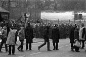Miners Strike, working miners pass pickets at Silverwood Colliery. - John Sturrock - 1980s,1985,adult,adults,breaker,breakers,breaking,CLJ,coal,cross,crosses,crossing,DISPUTE,DISPUTES,force,INDUSTRIAL DISPUTE,man men,mass picket,MATURE,member,member members,members,men man,miner,miner