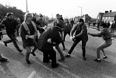 Pickets prevent a policeman arresting a picket, Mass picket in defiance of an injunction, Bentley colliery, Yorkshire Miners Strike. - John Sturrock - 1980s,1985,adult,adults,arrest,arrested,arresting,CLJ,collieries,colliery,DISPUTE,DISPUTES,force,INDUSTRIAL DISPUTE,injunction,Mass,mass picket,member,member members,members,mine,MINER,Miners,MINER'S,