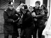 Police arrest pickets, Hatfield Main womens support group picket, Dunscroft miners welfare, Dovescroft, Doncaster, Yorkshire, the Miners strike - John Sturrock - 1980s,1985,adult,adults,arrest,arrested,arresting,CLJ,DISPUTE,DISPUTES,FEMALE,INDUSTRIAL DISPUTE,MATURE,member,member members,members,MINER,miners,MINER'S,miner's strike the miners strike,miners wives