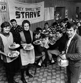 They shall not starve, Hemsworth kitchen, women with meals for striking miners, nr Pontefract, West Yorkshire - John Sturrock - 1980s,1984,banner,banners,Christmas,communities,community,disputes,donated,FEMALE,food,FOODS,group,groups,INDUSTRIAL DISPUTE,kitchen,KITCHENS,MEAL,meals,member,member members,members,MINER,miners,MINE