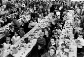 Miner's Strike children enjoying a Christmas party, Frickley colliery welfare with food donated from supporters, South Elmsall, Yorkshire - John Sturrock - 1980s,1984,boy,boys,cake,cakes,child,CHILDHOOD,children,Christmas,collieries,colliery,communities,community,disputes,eat,eating,enjoying,enjoyment,female,females,food,FOODS,Frickley,fun,girl,girls,hav