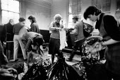 Sorting through clothes donated by supporters of the strike, Shirebrook Miners Welfare, Derbyshire - John Sturrock - 10-12-1984