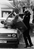 Senior police officer attacking a miner guarding his car. The attempt to prosecute the miner for riot collapsed. Orgreave coke works Miners strike Sheffield South Yorkshire - John Harris - 1980s,1984,adult,adults,attack,attacking,baton batons,Battle of Orgreave,BSC,CLJ,coke works,coking plant,conflicts conflict,DISPUTE,DISPUTES,guarding,hit,hitting,INDUSTRIAL DISPUTE,mass picket,MATURE,