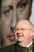 Eric Pickles, Conservative Party Chairman, posing for photographs and speaking to the press in front of a bill board with David Cameron on. The Conservative Party launch their draft manifesto for the... - Justin Tallis - 04-01-2010