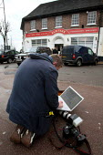 Paul Hackett, Times Newspaper Photographer, filing images of Dominic Kennedy using a laptop and broadband, Investigations Editor of The Times, just after his was forcably removed by BNP security from... - Justin Tallis - 14-02-2010