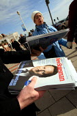 Handing out free copies of New Statesman magazine with David Cameron on the cover. Conservative Spring Forum, Brighton. - Justin Tallis - 2010,2010s,CONSERVATIVE,Conservative Party,conservatives,magazine,magazines,media,mp,mps,pol,pol politics,political,politician,politicians,politics,Spring