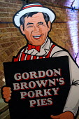 Gordon Browns Porky Pies at an event where Conservative leader David Cameron is giving a speech to party supporters. Shoreditch, London. - Justin Tallis - ,2010,2010s,brown,browns,CONSERVATIVE,Conservative Party,conservatives,funny,giving,gordon,Humor,HUMOROUS,HUMOUR,joke,JOKES,joking,Labour Party,leader,Lie,lies,party,pie,pies,pol politics,pork,porky,s