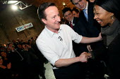 Conservative leader David Cameron shaking hands with supporters after giving a speech. Shoreditch, London. - Justin Tallis - ,2010,2010s,BAME,BAMEs,Black,BME,bmes,CONSERVATIVE,Conservative Party,conservatives,David Cameron,diversity,ethnic,ethnicity,FEMALE,giving,hands,leader,minorities,minority,mp,people,person,persons,poc