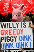 Placard reading Willy is a greedy Piggy referring to British Airways Willie Walsh. British Airways cabin crew three day strike over pay and working conditions. London Heathrow Airport. - Justin Tallis - 20-03-2010