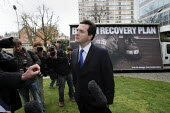 George Osborne speaking to the press as he unveils a new Conservative Party Campaign poster outside Conservative HQ. London. Brown recovery Plan: Jobs Tax More Debt - Justin Tallis - 2010,2010s,advert,ADVERTISED,advertisement,advertisements,advertising,ADVERTISMENT,adverts,billboard,billboards,campaign,campaigning,CAMPAIGNS,Conservative,Conservative Party,conservatives,DEMOCRACY,E