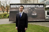 George Osborne unveils a new Conservative Party Campaign poster outside Conservative HQ. London. Brown recovery Plan: Jobs Tax More Debt - Justin Tallis - 05-04-2010