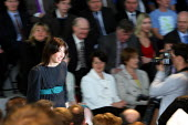 Samantha Cameron being photographed by the press as she takes her seat at The Conservative party's manifesto launch. Battersea London. - Justin Tallis - 13-04-2010