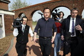 David Cameron walking through the media after giving a speech to Conservative Party supporter at a campaign event in Thurrock, Essex. - Justin Tallis - 24-04-2010
