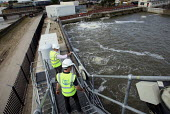 Workers look over salinity tanks at Thames Gateway Water Treatment Works. It is first plant of its kind to be built in the UK converting brackish water from the River Thames into clean drinking water... - Justin Tallis - 17-06-2010