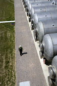 A worker walks past horizontal salinity buffer tanks at Thames Gateway Water Treatment Works. It is first plant of its kind to be built in the UK converting brackish water from the River Thames into c... - Justin Tallis - 17-06-2010