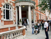 Parents picking up their children at the end of the day. Gems Hampshire School, Chelsea, London. Dubi biased GEMS Education will be one of the private providers of Academy and Free Schools. - Justin Tallis - 2010,2010s,AFFLUENCE,AFFLUENT,Bourgeoisie,child,CHILDHOOD,children,cities,city,edu,Edu education,educate,educating,education,educational,elite,elitism,EQUALITY,families,FAMILY,gems,hampshire,high,high