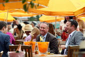 Racegoers enjoying themselves at Venue Cliquot champagne bar. Goodwood racecourse. - Justin Tallis - 29-07-2010