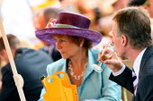 Racegoers enjoying themselves at Venue Cliquot champagne bar. Goodwood racecourse. - Justin Tallis - 2010,2010s,AFFLUENCE,AFFLUENT,alcohol,bottle,bottles,Bourgeoisie,champagne,Champagne Bottle,CHAMPAIGN,course,courses,drink,drinker,drinkers,drinking,elite,elitism,enjoying,ENJOYMENT,EQUALITY,glass,hig