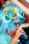 Ladies Day. Goodwood racecourse. - Justin Tallis - 2010,2010s,AFFLUENCE,AFFLUENT,alcohol,bottle,bottles,Bourgeoisie,Champagne Bottle,course,courses,day out,dress,dressed up,dresses,drink,drinker,drinkers,drinking,elite,elitism,enjoying,enjoyment,EQUAL