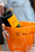 Empty bottle at Venue Cliquot champagne bar. Goodwood racecourse. - Justin Tallis - 2010,2010s,AFFLUENCE,AFFLUENT,alcohol,bottle,bottles,Bourgeoisie,champagne,Champagne Bottle,CHAMPAIGN,course,courses,drink,drinker,drinkers,drinking,elite,elitism,Empty,EQUALITY,high,high income,incom