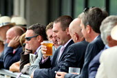 Enjoying a pint of beer. Goodwood racecourse. - Justin Tallis - 29-07-2010