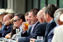 Enjoying a pint of beer. Goodwood racecourse. - Justin Tallis - 2010,2010s,AFFLUENCE,AFFLUENT,Bourgeoisie,CELEBRATE,celebrating,celebration,CELEBRATIONS,chance,course,courses,elite,elitism,EMOTION,EMOTIONAL,EMOTIONS,Enjoying,ENJOYMENT,EQUALITY,event,funny,gamble,g