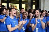 Cheering and clapping the customers as Apple opens a new store in Covent Garden, London. - Justin Tallis - ,2010,2010s,apple,at,BAME,BAMEs,Black,BME,bmes,bought,buy,buyer,buyers,buying,Celebrate,celebrates,CELEBRATING,CELEBRATION,celebrations,cheer,cheers,cities,city,commodities,commodity,COMPUTE,COMPUTER,