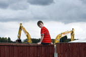 A traveller boy looks on as diggers begin to raise to the ground their pitch of land, legally owned by the travellers, after the council served an eviction notice. Hovefields Drive in Basildon. - Justin Tallis - 07-09-2010