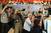 Press photographers working at the 2010 Conservative Party Conference, Birmingham. - Justin Tallis - 06-10-2010