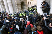 Riot police clash with students trying to get out of the kettle. Protest against education cuts and increased tuition fees, Whitehall, London. - Justin Tallis - 24-11-2010