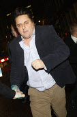Nick Griffin BNP is chased away down the street holding a member of his security teams hand after anti fascist protesters prevented him from speaking on a Q and A panel at The Front Line Club. London. - Justin Tallis - 13-01-2011