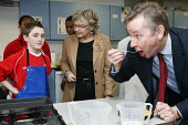 Michael Gove tasting a dish in a food technology lesson whilst visiting Haberdashers Askes Knights Academy with the new schools commissioner Dr Elizabeth Sidwell. Bromley, London. - Justin Tallis - 14-01-2011