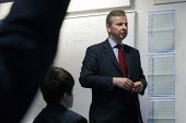 Michael Gove interacting with pupils in a lesson whilst visiting Haberdashers Askes Knights Academy. Bromley, London. - Justin Tallis - 14-01-2011