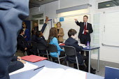 Michael Gove interacting with pupils in a lesson whilst visiting Haberdashers Askes Knights Academy with the new schools commissioner Dr Elizabeth Sidwell. Bromley, London. - Justin Tallis - 14-01-2011