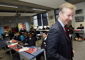 Michael Gove walking out of a classroom whilst visiting Haberdashers Askes Knights Academy. Bromley, London. - Justin Tallis - 2010s,2011,academies,academy,ark,BAME,BAMEs,BME,bmes,CHILD,CHILDHOOD,children,cities,city,Class,classes,Classroom,CLASSROOMS,CONSERVATIVE,Conservative Party,conservatives,diversity,edu education,educa