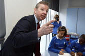 Michael Gove interacting with pupils in a maths lesson whilst visiting Haberdashers Askes Knights Academy. Bromley, London. - Justin Tallis - 14-01-2011